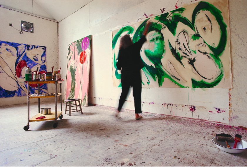 Lee Krasner painting Portrait in Green in her studio in Springs, 1969. Photograph by Mark Patiky.